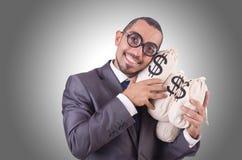 Man with money sacks Stock Photos