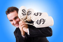Man with money sacks Royalty Free Stock Photography