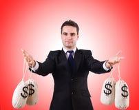 Man with money sacks on white Stock Photo