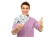 Man with money showing thumbs up. Young man standing over white background Stock Photo