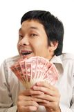 Man With Money Shrugging. Man holding a wad of Canadian fifty dollar bills shrugging and smiling Stock Photo