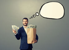Man with money and speech bubble Stock Photos