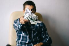 Man with money. A young man throws money dollars stock image