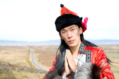 Man in Mongolian costume Stock Images