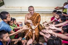 Man in Monk Dress Between Group of Children Royalty Free Stock Image