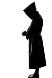 Man monk priest silhouette praying Royalty Free Stock Images