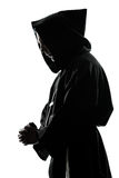 Man monk priest silhouette praying Stock Photo
