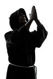 Man monk priest silhouette praying Stock Photos