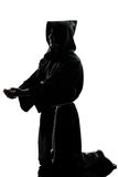Man monk priest silhouette praying Royalty Free Stock Photography