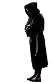 Man monk priest silhouette praying Royalty Free Stock Images