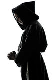 Man monk priest silhouette praying Royalty Free Stock Image
