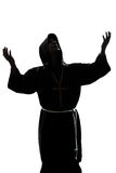Man monk priest silhouette praying Royalty Free Stock Photos