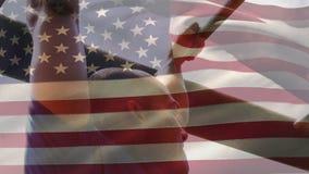 Man on monkey bars and American flag
