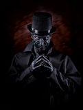 Man in monster makeup. Studio portrait of a man in monster makeup, dark background Stock Images