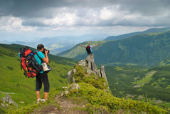 Man in montains is photographing Stock Image