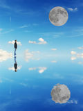 Man and moon. Man looking at the moon in a blue background Stock Images