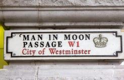 Man in moon passage street sign, London Stock Photos