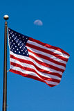 Man on the Moon-1. U.S. flag waving with half moon in the background Stock Photo