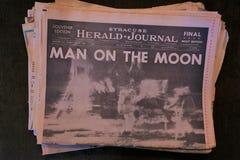 Man on the Moon yellowed newpaper headline stock photo