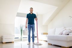 Man with mop and bucket cleaning floor at home Royalty Free Stock Photography
