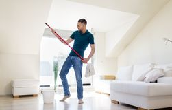 Man with mop and bucket cleaning floor at home Stock Image