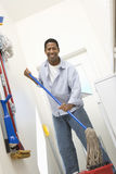 Man With Mop Cleaning House Stock Images