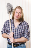 Man with mop in hands Stock Image