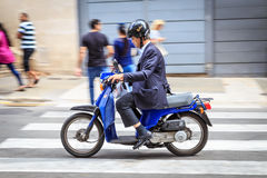 Man on moped Royalty Free Stock Photography