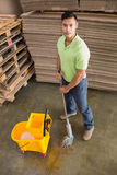 Man moping warehouse floor. Portrait of man moping warehouse floor Stock Image