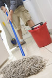 Man Mopping On The Floor Stock Images
