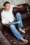Man in the morning. Man reads morning newspaper on the sofa Royalty Free Stock Image