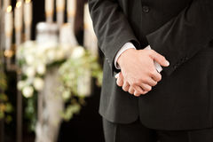 Man or mortician at funeral mourning
