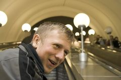 Man in Moscow Metro. At escalator, smiling Stock Image