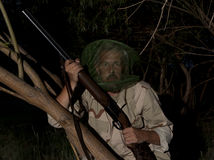 Man in mosquito net ready to hunt with hunting rifle Royalty Free Stock Images