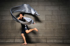 Man in Motion 17. Pictures of people swirling fabric in motion. Useful for context on creativity or artistic expression or freeze motion. Every Picture is Royalty Free Stock Images
