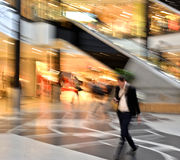 Man in motion at the modern shopping mall. Intentional motion blur Royalty Free Stock Photos