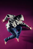 Man in motion. On pink background studio shot Stock Images