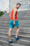 Man in motion on stairs looks back urban background. Every step brings him closer to success. Sportsman workout on stock photography