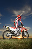Man on Motocross Motorcycle Royalty Free Stock Photos