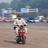 Man on a motor bike with breath protection, Beijing, China Stock Images