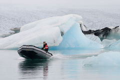 Man in motor boat in Jokulsarlon lagoon Stock Photography