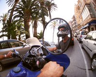 Man on motorbike. Man rides in street on his motorbike, sitges, spain Stock Image