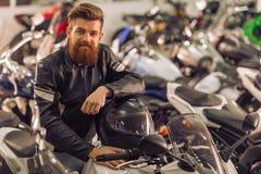 Man with motorbike Stock Image