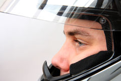 Man in motorbike helmet. On gray background Royalty Free Stock Photography