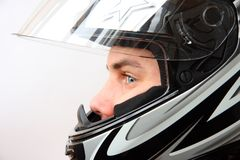 Man in motorbike helmet Stock Images
