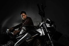 Man and motorcycle Stock Photos