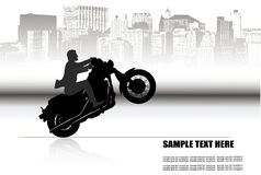 A man on a motorcycle on the background of the city Royalty Free Stock Images