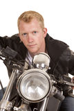 Man on motorcycle black jacket lean forward facing close Royalty Free Stock Photos