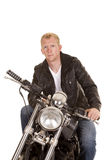 Man on motorcycle black jacket look serious Stock Photography