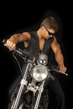 Man on motorcycle black vest dark glasses look down Royalty Free Stock Image
